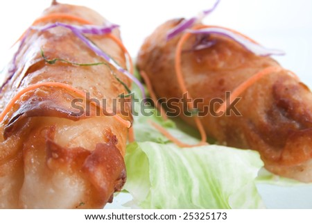 Close up of Fried Roll over lettuce - selective focus on one roll (left)