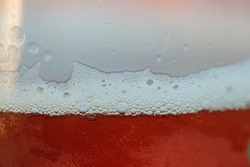 Close up of froth in a glass of indian pale ale