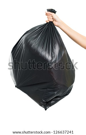 Close up of garbage-bag holding by hand
