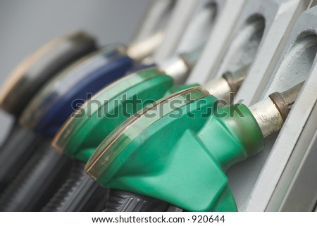 Close up of gas nozzles. Shallow depth of field with focus on the first nozzle.