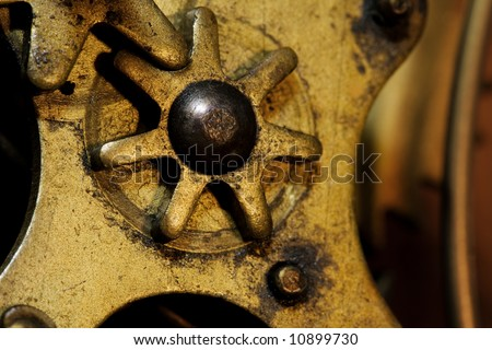 Close-up of gears inside an old grandfather clock - stock photo
