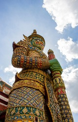 Close up of Giant statues in the Thai temple with blue sky and white cloud, Thailand.