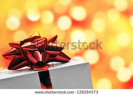 close up of gift box bow on shiny background