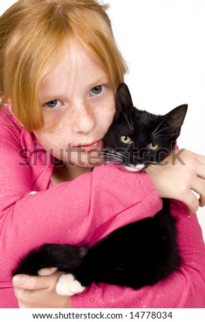 close up of girl and kitten
