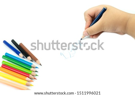 Close up of girl hand with pencil writing english words by hand on  white notepad paper at white background, Child learning to write letters of the alphabet