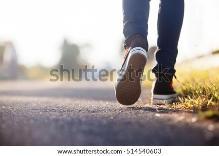 Close up of girl shoes walking