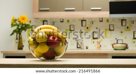 close-up of glass bowl with fruits on kitchen countertop