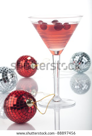 Close up of glass of Limomcello Cosmo Cocktail over white, arranged Christmas ornament. Most popular cocktails series.