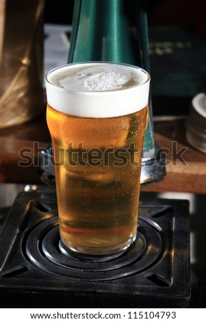 close up of glass with beer placed at the bar
