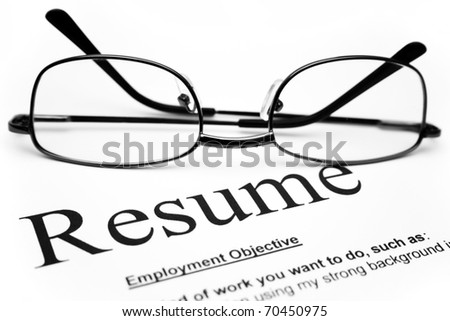 Close up of glasses on resume