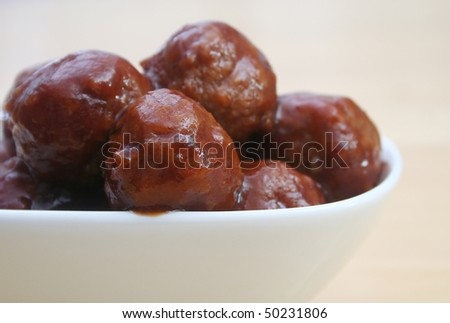Close Up of Glazed Meatballs in white bowl - stock photo