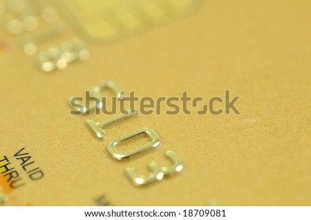 Close up of golden credit card numbers (with copyspace) - stock photo