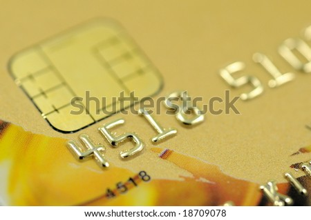Close up of golden credit card with chip