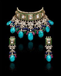 Close up of Golden necklace having emerald, turquoise, alexandrite with earrings isolated on black background.