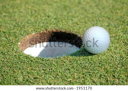Close-up of Golf Ball Going in the Hole