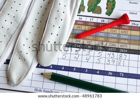 Close up of Golf Score Card with Glove, Pencil, & Tee