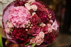 close-up of gorgeous large bright flower bouquet of pink roses and hydrangeas and peonies with decorative berries