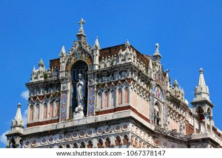 Close-up of Gothic Revival style Capuchin Church of Our Lady of Lourdes with carvings, reliefs and statue of Mary against the blue sky in a sunny summer day, downtown Rijeka port city Croatia Europe
