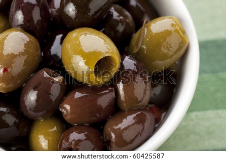 Close up of green and black Spanish olives.
