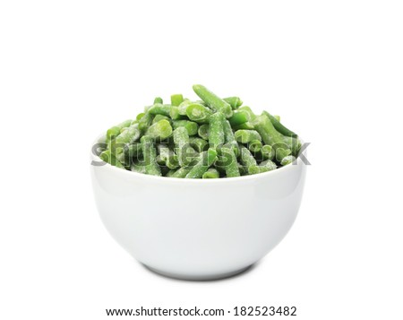 Close up of green beans in bowl. Isolated on a white background.