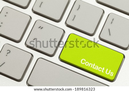 Close Up of Green Contact Us Key Button on Keyboard.