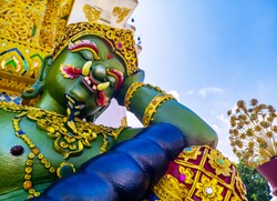 Close up of green giant and satyr statue in temple. Thailand traditional object. Thai temple symbolic giant. The guardian of the butthist temple.