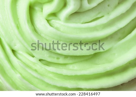Close up of green icing on a cup cake
