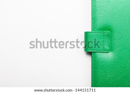 Close up of green leather cover of notebook - stock photo