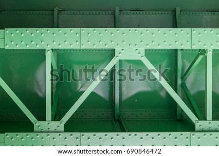 close up of green metal bridge structure for support trains #690846472