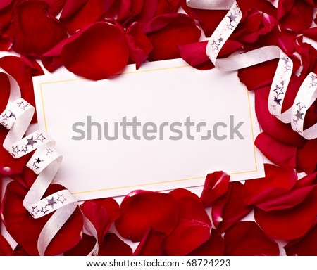 close up of greeting card with rose petals decoration