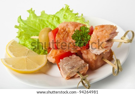 Close up of grilled salmon with vegetables