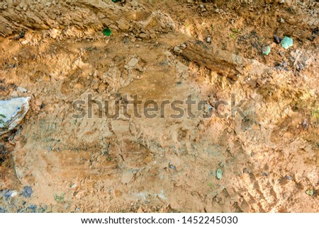 Close-up of ground with dirt and sand soil in random with small stones. Randomly sketched dirty loose coarse sand interspersed with debris and small gravel