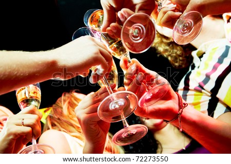 Close-up of group of friends cheering up at party - stock photo