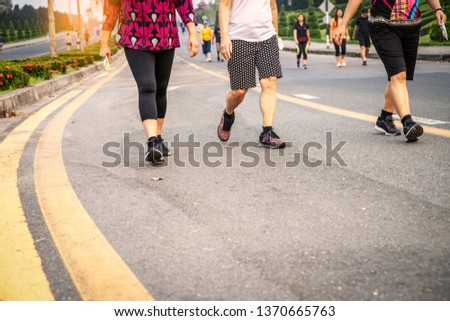 close up of Group senior woman legs walking at the park in the evening,  exercise for health concept,- image #1370665763