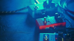 Close up of guitar pedals. music effect loop machine. Macro view