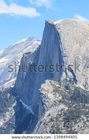 Close up of Half Dome. It is a granite dome in Yosemite National Park, California. Landmark of Yosemite NP. View from Glacier Point