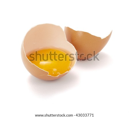 close up of halved broken egg on white background, with clipping path