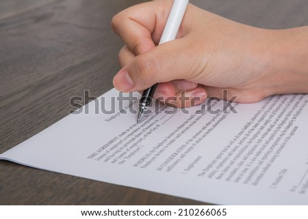 Close up of hand completing an employment application form