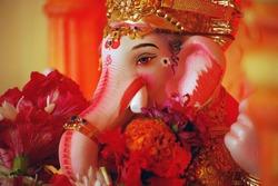 Close-up of hand crafted clay idol of Hindu god Ganesha - Lord of good omen