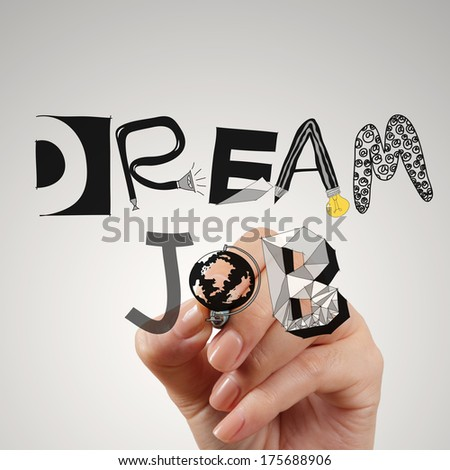 close up of hand drawing design words DREAM JOB as concept