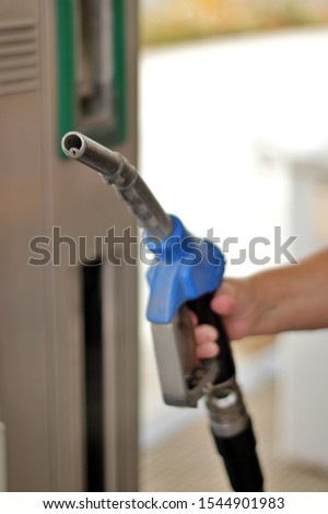 Close-up of hand held fuel pump gun. End of fossil fuels and new energies #1544901983