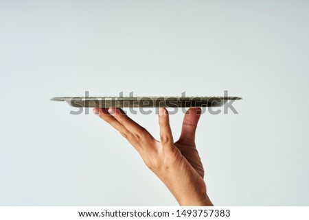 close up of hand holding a empty tray