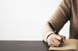 Close up of Hand holding pen, it's like a letter writer. Creative idea of work 2019 goals, writing, drawing,making notes in document.Business,investment,concept,Vintage ,Retro natural mood style.