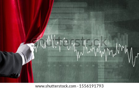 Close up of hand in white glove open red velvet curtain to infographs #1556191793