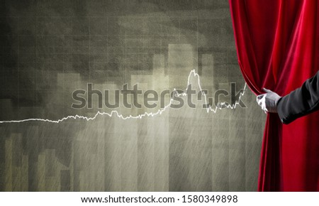 Close up of hand in white glove open red velvet curtain to infographs #1580349898