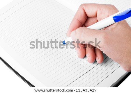 Close up of hand making notes