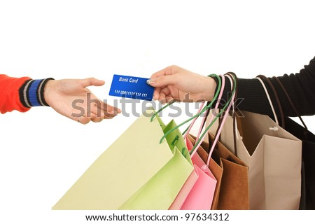 Close-up of hand passing over credit card to shop assistant after shopping MasterCard