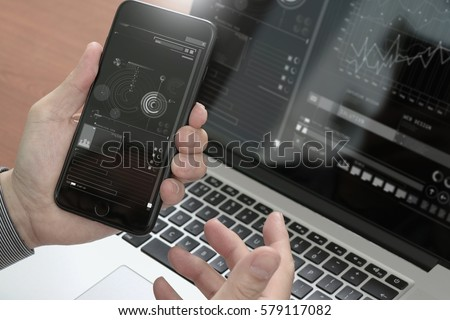 close up of hand using smart phone,laptop, online banking payment communication network technology 4.0,internet wireless application development sync app #579117082