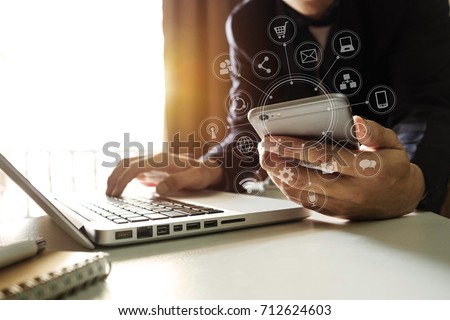 close up of hand using tablet ,laptop, and holding smartphone online banking payment communication network,internet wireless application development sync app,virtual graphic  icon diagram   #712624603