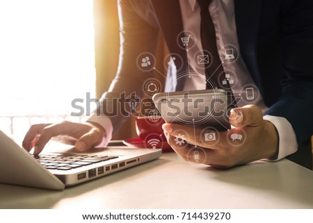 close up of hand using tablet ,laptop, and holding smartphone online banking payment communication network,internet wireless application development sync app,virtual graphic  icon diagram